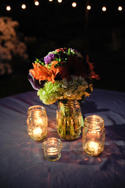 It's all about the ambiance! :  wedding candles green mason jars orange outdoor wedding purple reception string lights  DSC8674
