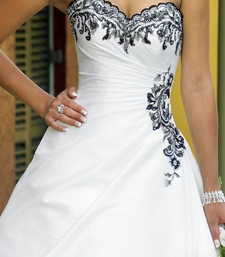 I am looking for a black white wedding dress for a winter wedding in 2012