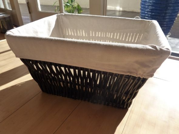 The linen lining is removable and washable Basket measures approximately L