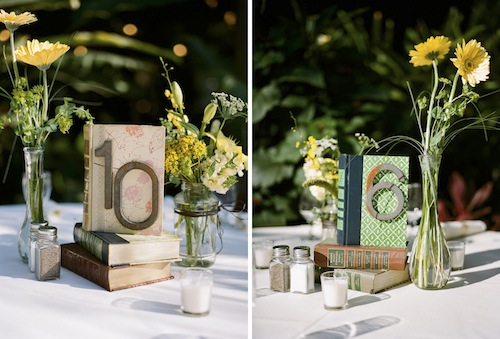 Books bud vases and flowers for the centerpieces the