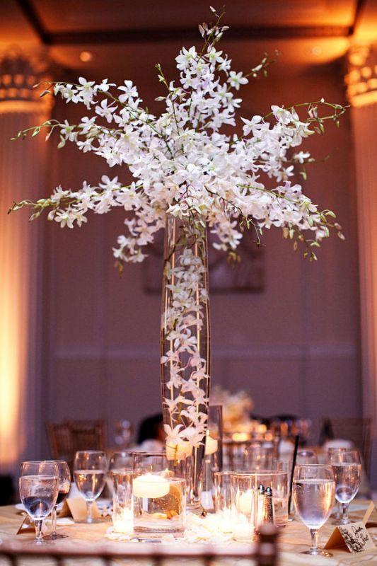 DIY feather centerpieces are an easy way to add some glamour and elegance to any wedding, event, party or dinner. Because they are tall, they are perfect on tables where you want people to .