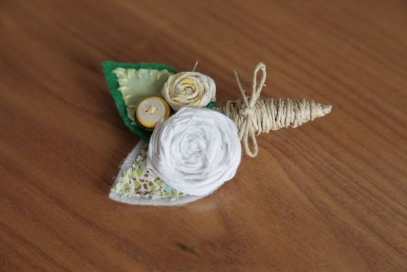 I made my own Boutonnieres :  wedding boutonnieres ceremony diy flowers green ivory silver white yellow Groom