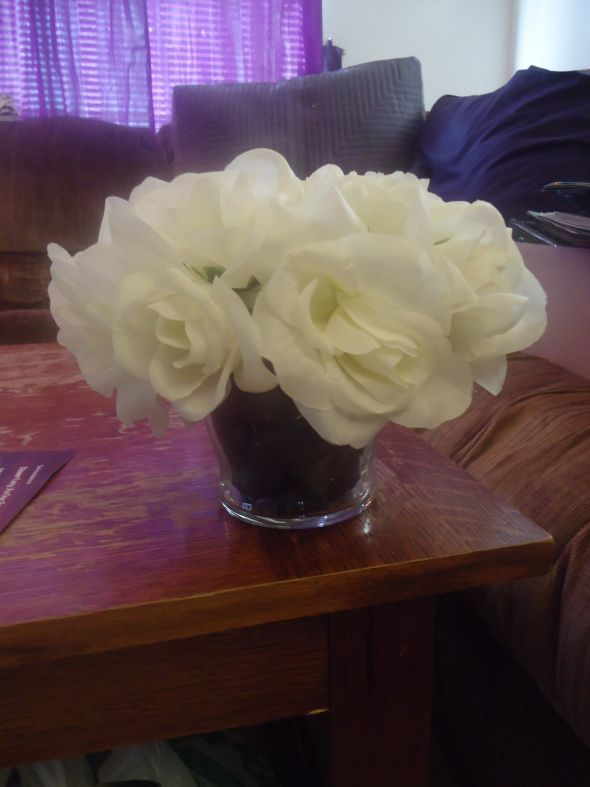 6 white rose centerpieces with glass bottom and black river rock