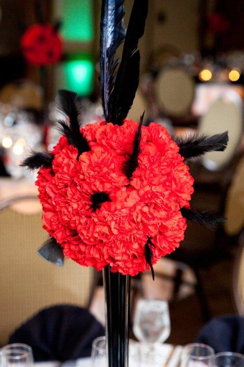 Wedding Centerpieces Photos wedding feathers black red flowers reception