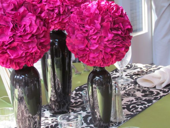 Centerpieces I 39d use for the receptionfuchsia hydrangea balls with black