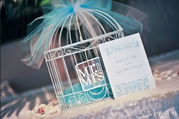 Chair covers Table linen Birdcage Placecard holders and flower baskets