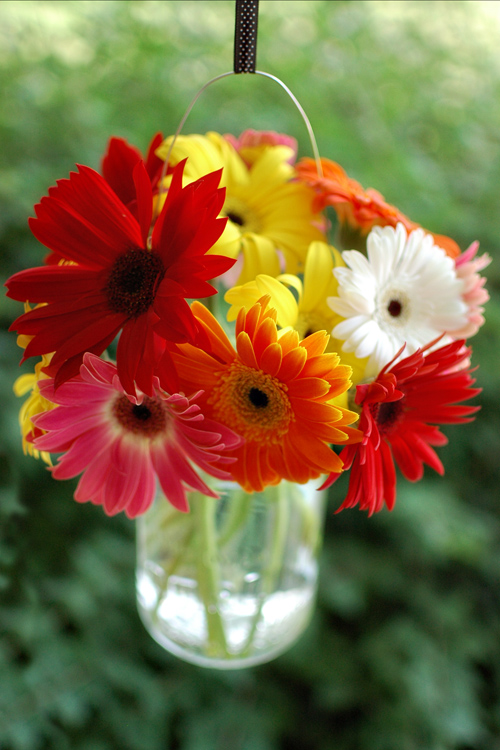 wedding mspanda centerpieces gerber daisies mason jars wood