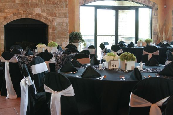 LOL Black banquet chair covers white sashes and black napkins wedding