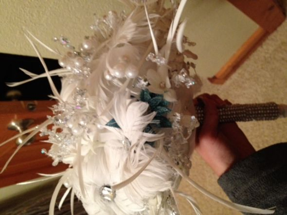 A feather style wedding bouquet that I am absolutely in love with modeled