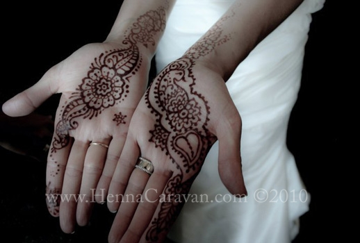 Bridal Henna on a caucasian girl in a white wedding dress wedding