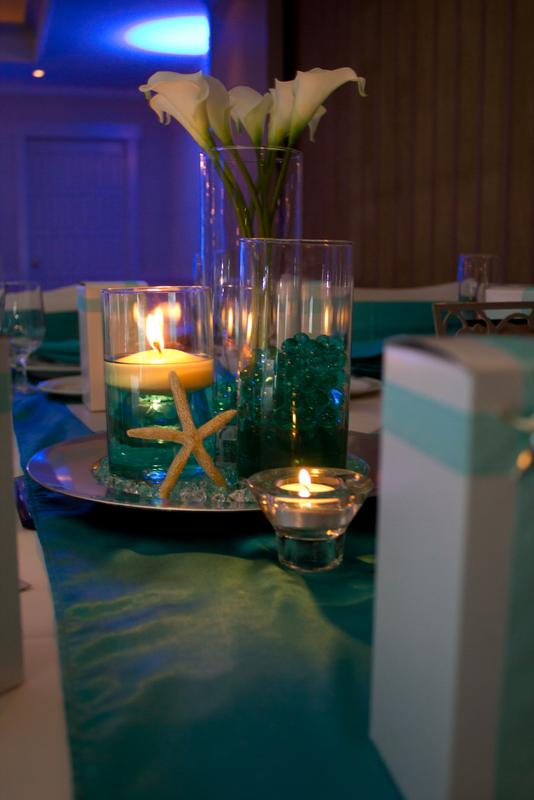The following centerpieces were created for a beach themed wedding ...