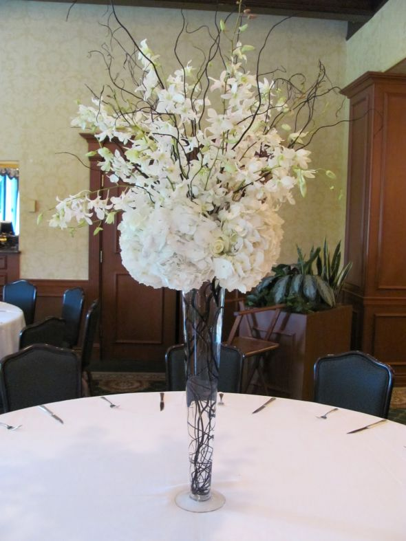 Artificial flowers for the reception so this is exactly my centerpiece so my question is can i pull this off with artificial flowers i already have the branches and also should i go with junglespirit Images