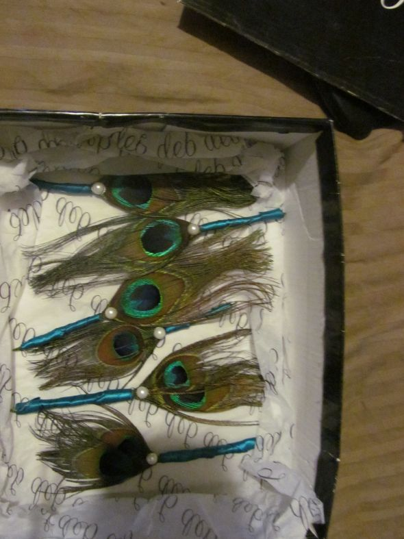 peacock feather boutonnieres