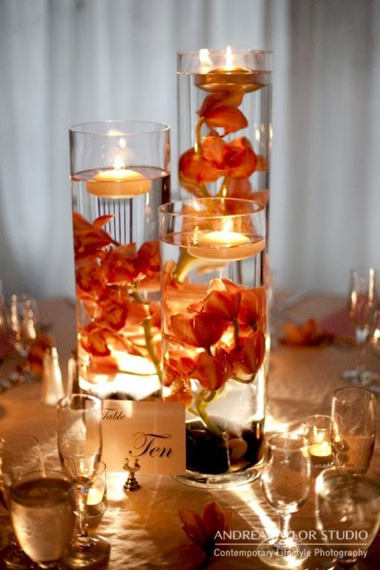 Red Orchid Centerpiece :  wedding orange reception red Orchids Submerged In Tall Vases Centerpiece