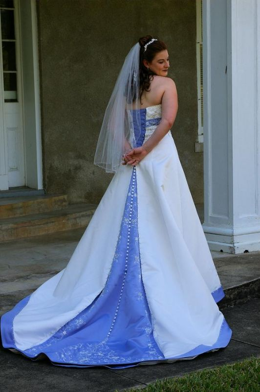 Mori Lee by Madeline Gardner halter wedding gown with blue accents and