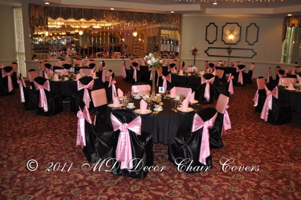 Black Table Cloth With Black Chair Covers And Light Pink Sash:
