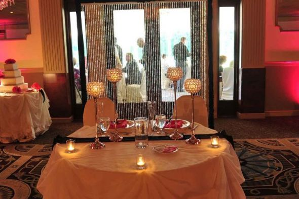 Sweetheart table with crystal backdrop Photos courtesy of Brad Glazier :  wedding black pink reception white Stable2