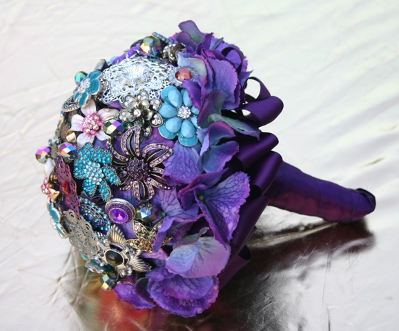Not a flower person :  wedding black blue bouquet flowers gold teal Peacock