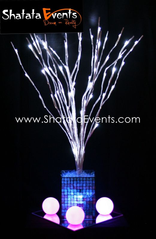 Ostrich feather centerpieces and LED Branch centerpieces for rent wedding