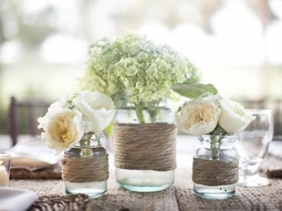 8 ways to use mason jars wedding style vie magazine aisle markers swoon worthy hydrangeas make their home in a mason jar and play their role as aisle markers create a sling for the jar out of wide satin junglespirit Gallery