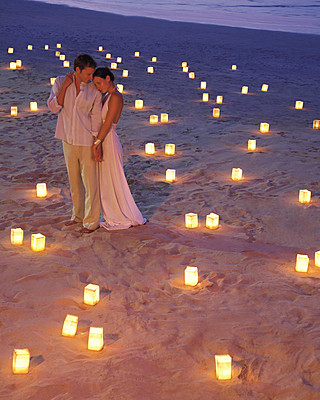 any pics of evening beach weddings?? :  wedding beach candles evening lighting torches Beach Wedding
