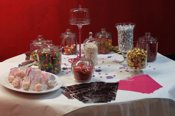 Simple Candy Buffet at the reception. :  wedding apothecary jars blue cake cake pops candy candy buffet fun gold green pink reception red silver Candy Buffet With Apothecary Jars Cake Pops  Skittles  Truffles  Jumbo Lollipops  And Goodie Bags