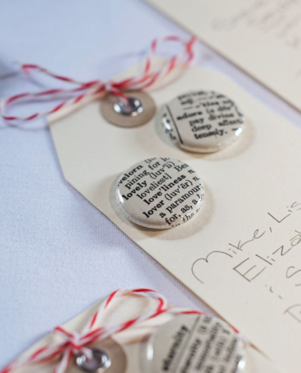 Escort cards: hang tags with buttons from dictionary pages :  wedding diy escort cards hang tag escort cards ivory reception red rustic rustic escort cards rustic wedding vintage accessories vintage buttons white Escortcards1cjaj1
