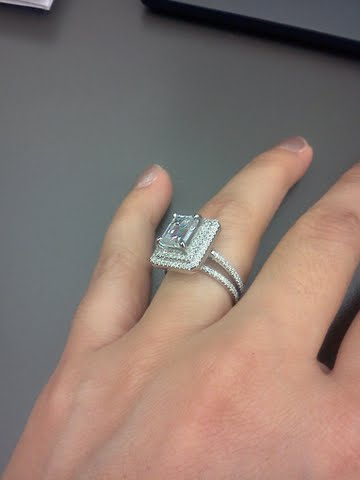 my 2ct emerald cut surrounded by a halo with