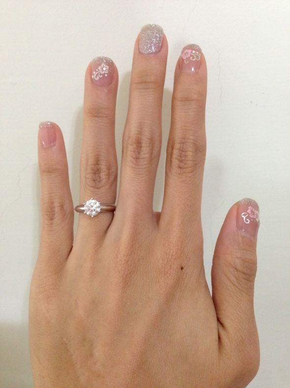 I\'d love to see your nail colors (and rings)! :D