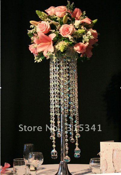Real flowers versus fake flowers please help i want to know if i should use real flowers or silk flowers for my centerpeices please help i have attached photos of what i would like my centerpeices to mightylinksfo