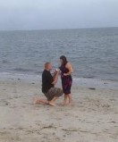 Surprise Vacation proposal on the Beach at Cape Cod
