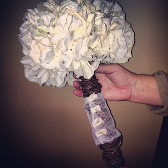 Ivory bouquet with part of grandmothers dress as wrap