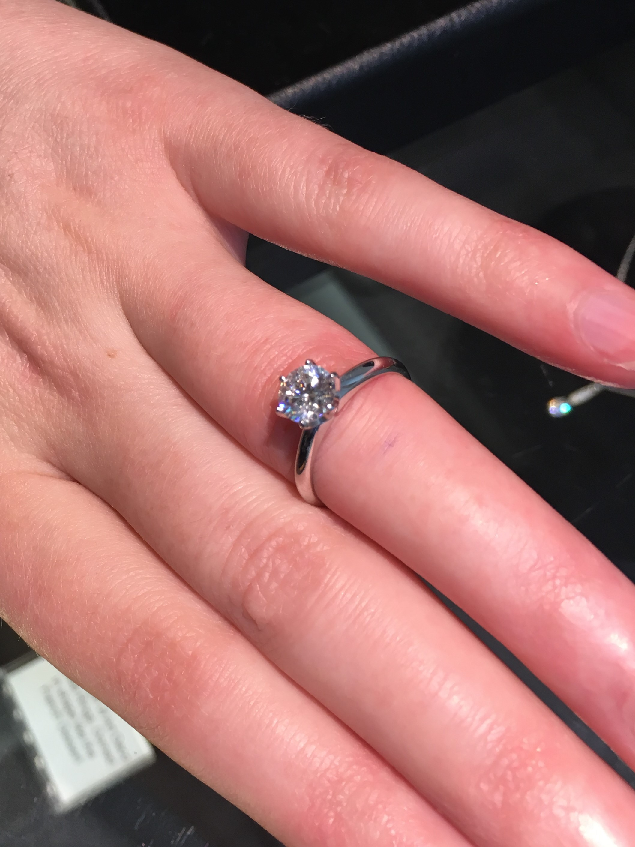 Please help me find an engagement ring (round solitaire, plain band)