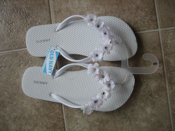 Diy saturday flip flops for my girls and wanted to bedazzle them up a little and so i added some flowers to white flip flops for them they will be in alfred angelo mightylinksfo