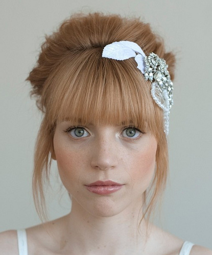 bangs aren't straight, but this style could work with straight bangs ...