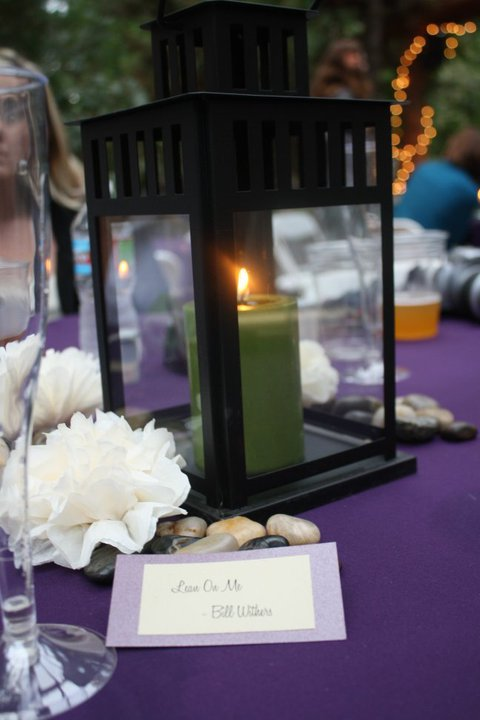 Purple green tablecloths napkins lantern centerpieces wedding