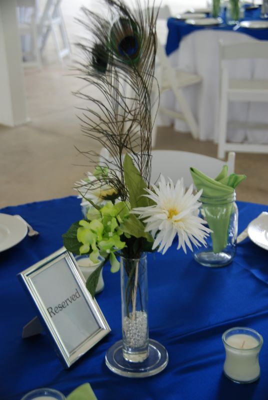 Peacock Feather Centerpieces silk flowers candles wedding candles