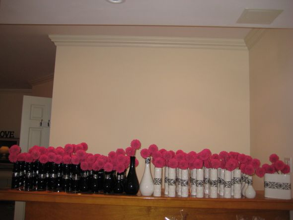 I HAVE ABOUT 50 WHITE AND 50 BLACK VASES WITH 2 HOT PINK FLOWERS IN EACH