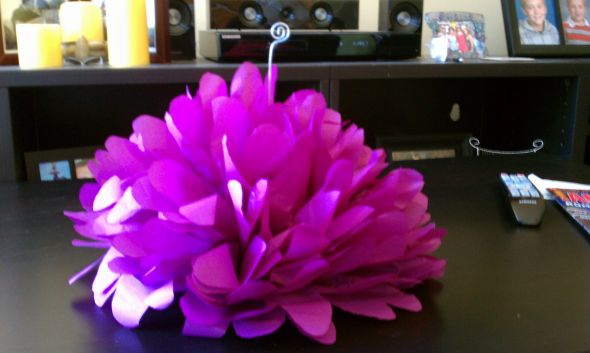 i had made some tissue paper flower centerpieces but they were just a half pom sitting on the table like this