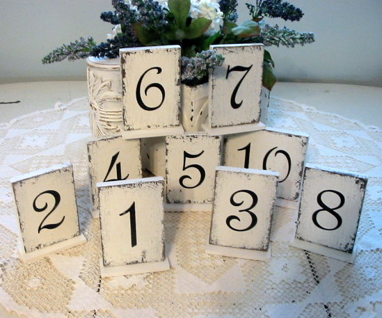 The Vintage inspired table numbers 114 were purchased at The Back Porch