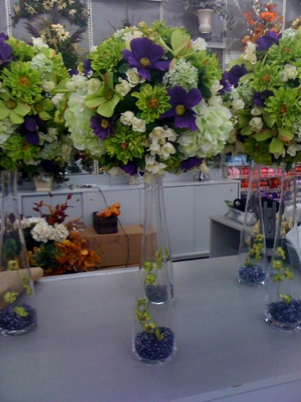 Dacia s votive candles to accent the centerpieces