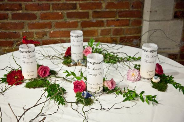 Rustic memorial table wedding memorial flowers luminaries pink red