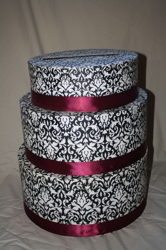 This beautiful handmade wedding card box is of a black and white damask