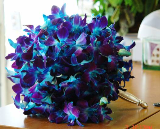 The gorgeous turquoise yellow and purple bouquet at the left is an